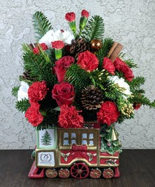 A festive arrangement designed in a limited edition Spode container.