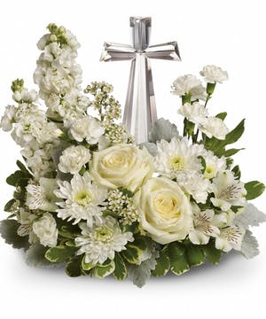 All white flowers surrounding a crystal cross.