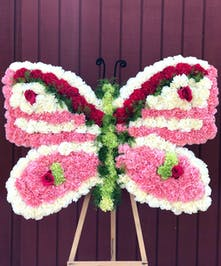 Floral butterfly made of carnations and roses for a memorial service.