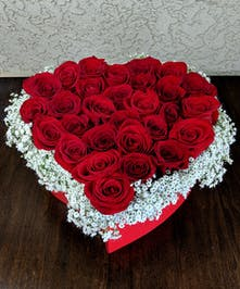 A lovely design featuring roses in the shape of a heart designed in a box