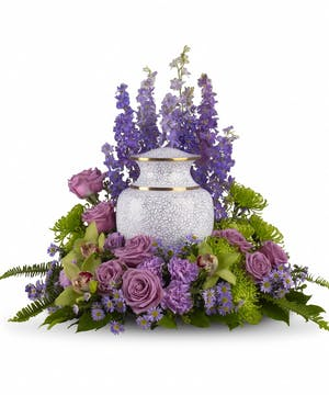 Cremation bouquet of lavender and green flowers to surround an urn or photograph.