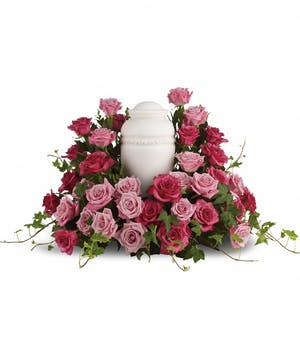Cremation bouquet of pink roses to surround an urn or photograph.