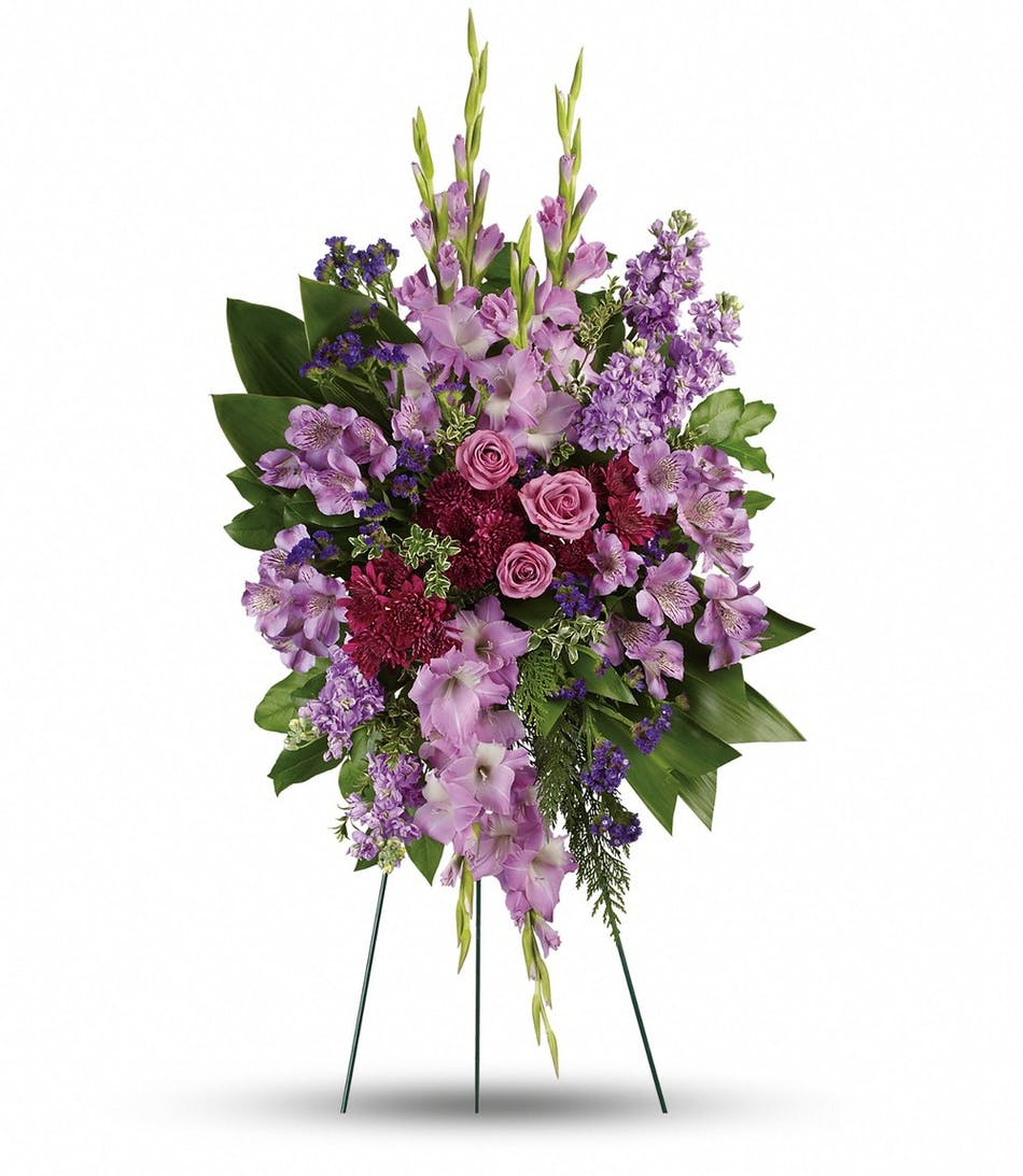 Rowland heights funeral flowers lavender reflections spray ra lavender colored flowers and greenery in a spray funeral arrangement izmirmasajfo