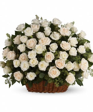 Sympathy basket of white and creme roses with eucalyptus.