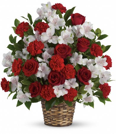 Sympathy basket of red roses, white alstroemeria and red carnations.