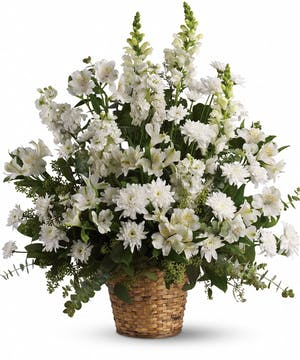 An exquisite funeral basket with all white flowers