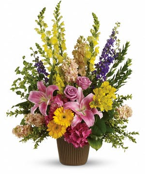 Sympathy basket of pink hydrangea, lavender roses, pink oriental lilies, yellow gerberas and more with greenery.