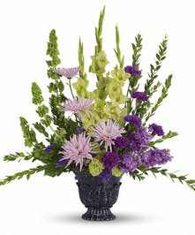 A serene funeral bouquet in lavender, green, and purple tones