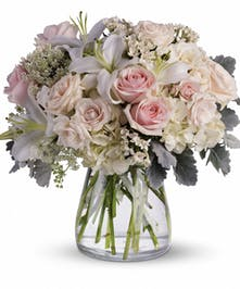 A gorgeous bouquet using soft pink and white flowers