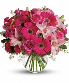 Pink flower bouquet in a clear glass bubble vase