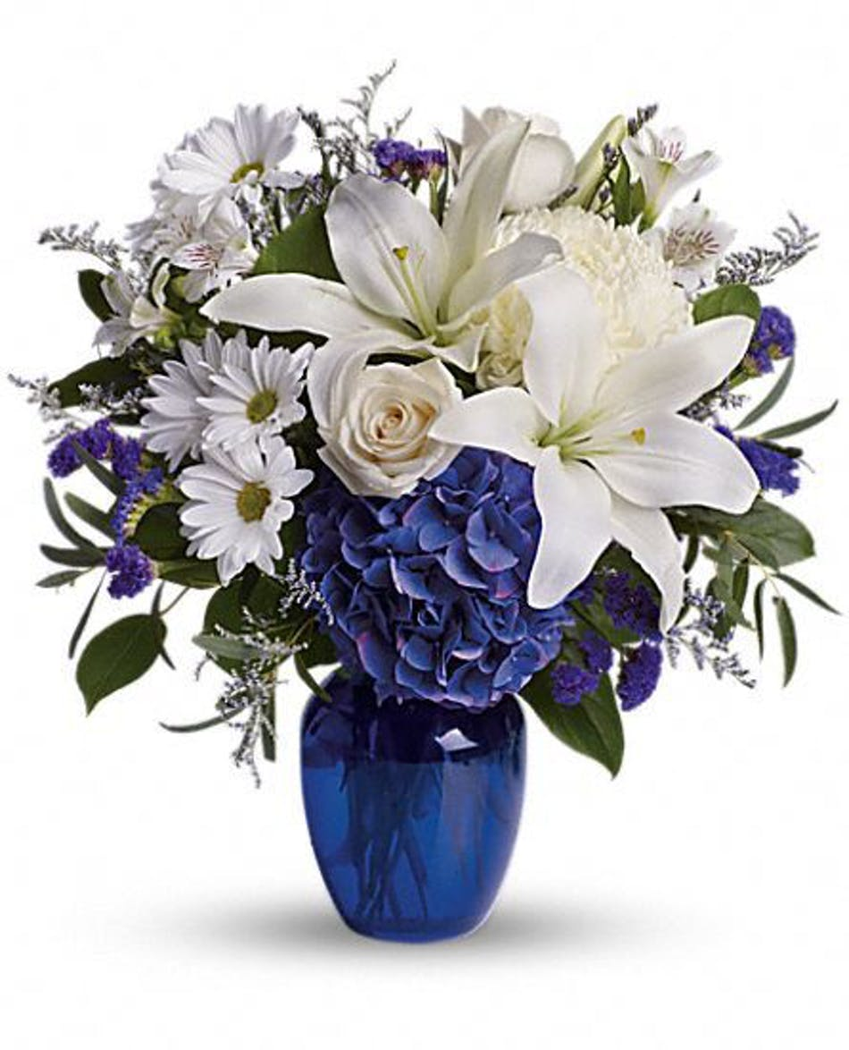 Rowland heights glendora whittier flower delivery touch of blue white flowers and dark blue hydrangea in a dark blue glass vase izmirmasajfo
