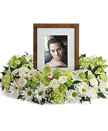 Cremation bouquet of white and green flowers to surround an urn or photograph.