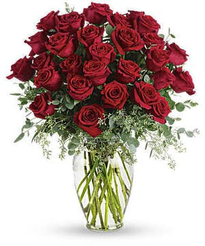Sympathy bouquet of all red roses and greenery.