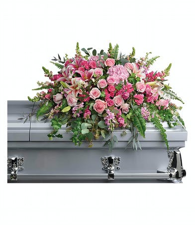Casket spray of pink hydrangea, roses, lilies, carnations and more.