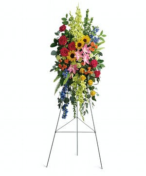 Bursting with joy, this radiant spray of rainbow blooms is an exuberant tribute to never-ending love.