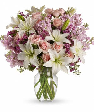 Light pink spray roses, white asiatic lilies, lavender stock and waxflower.