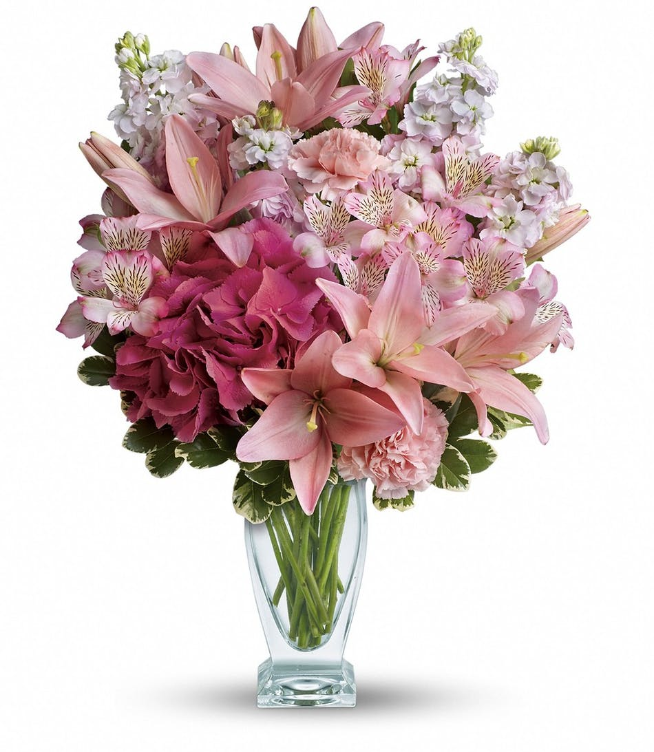 Blush of love lily hydrangea bouquet glendora ca pink lilies and hydrangea in a clear glass vase izmirmasajfo