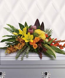 Tropical casket spray of orange orchids and roses, red gladioli, pink ice protea, yellow asiatic lilies and chrysanthemums.