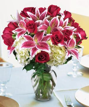 Stargazer lilies and red roses put love in the air!