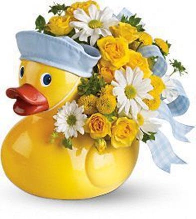 Keepsake duck vase filled with yellow and white flowers accented with blue ribbon.