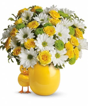 Yellow vase and chickadee accent with yellow, white and green flowers.