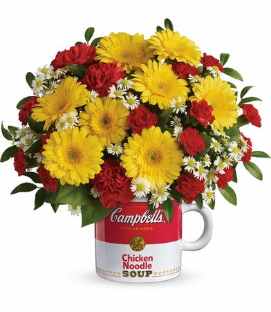 Campbell's Get Well Mug filled with yellow gerbera daisies, white monte cassino asters, lemon leaf and huckleberry. A great Get Well gift.