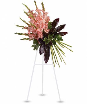 Sympathy spray of coral gladioli and greenery.