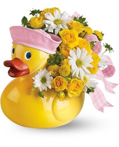 Duck keepsake vase with yellow and white flowers and pink ribbon.