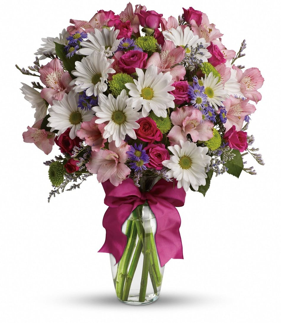 Lovely bouquet in rowland heights whittier glendora ca pink purple white and green flowers in a clear glass vase tied with a izmirmasajfo