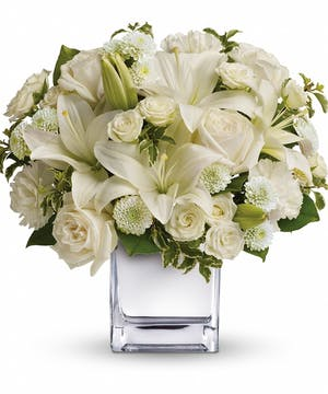 All-white bouquet of roses, carnations and more accented with greenery