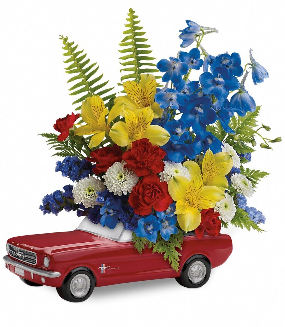 65 ford mustang flower arrangement rowland heights florist 1965 ford mustang keepsake container holds yellow red and blue flowers great for a izmirmasajfo