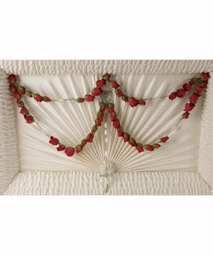 Floral rosary of red roses for the interior of the casket.
