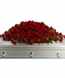 Red rose casket spray.