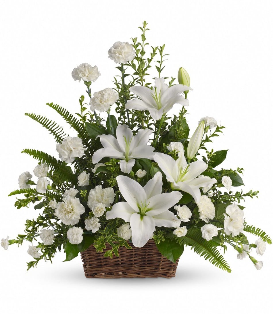 Peaceful white lilies sympathy basket for funeral service white lilies and other white flowers in a funeralsympathy basket izmirmasajfo
