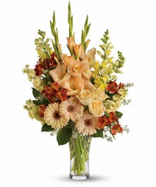 An impressive bouquet of peach, orange, and yellow flowers!