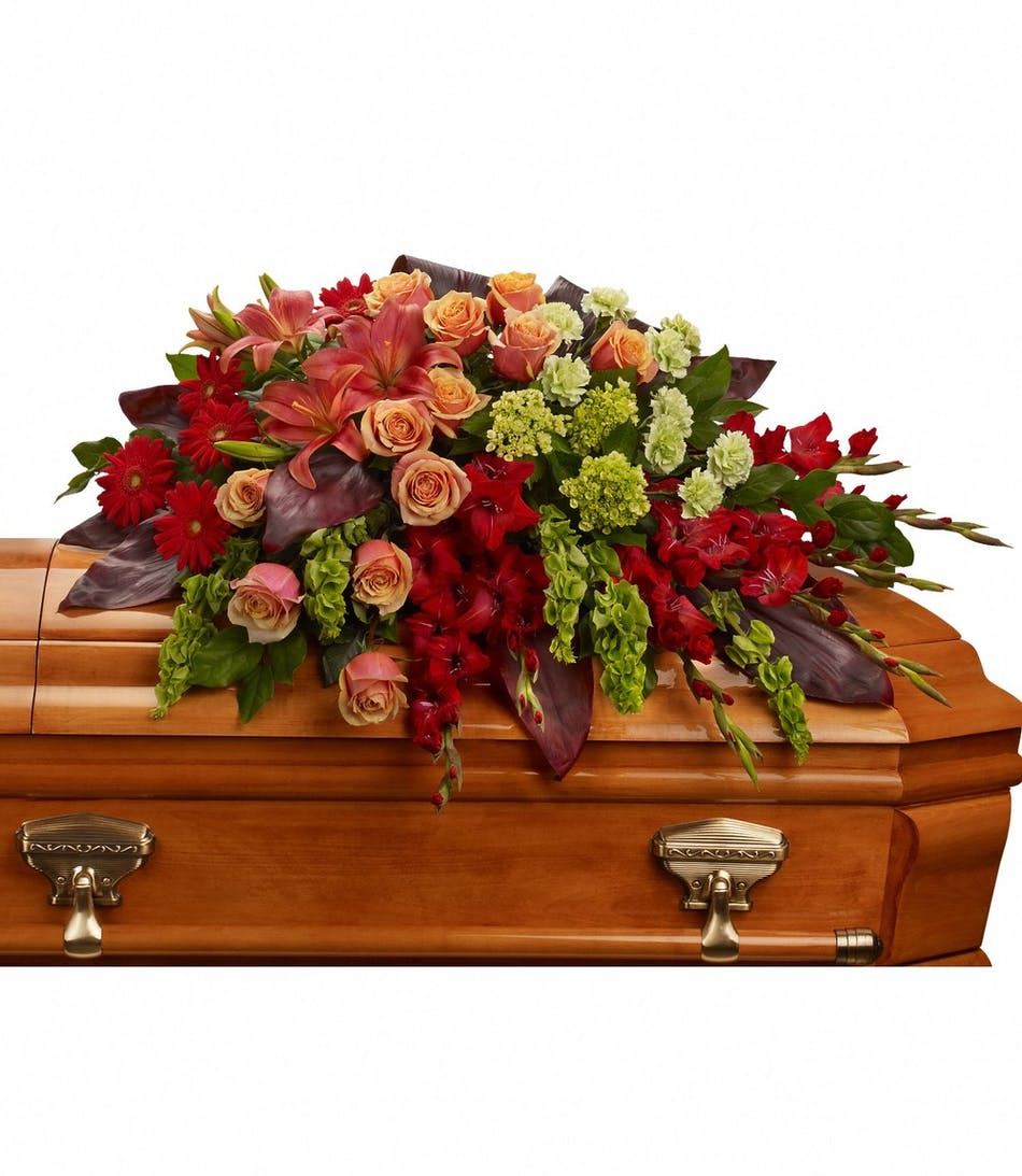 A Fond Farewell Red Orange Casket Spray Funeral Flowers