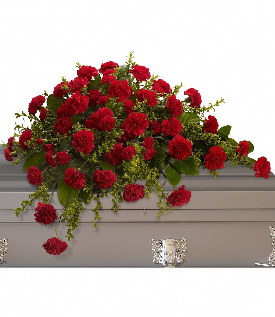 Red brilliance casket spray funeral flower arrangement half couch casket spray of red carnations and greenery izmirmasajfo