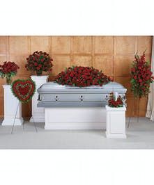 Set of six sympathy arrangements crafted with all-red flowers and greenery.