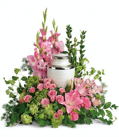 Cremation tribute bouquet of green and pink flowers accented with greenery.