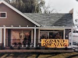 A large Grand Opening sign announces we're open for business, circa 1984