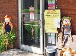 Stuffed scarecrows welcome visitors to the front door of our Whittier showroom