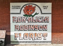 Our hand-painted sign still hangs on the wall of our Rowland Heights location